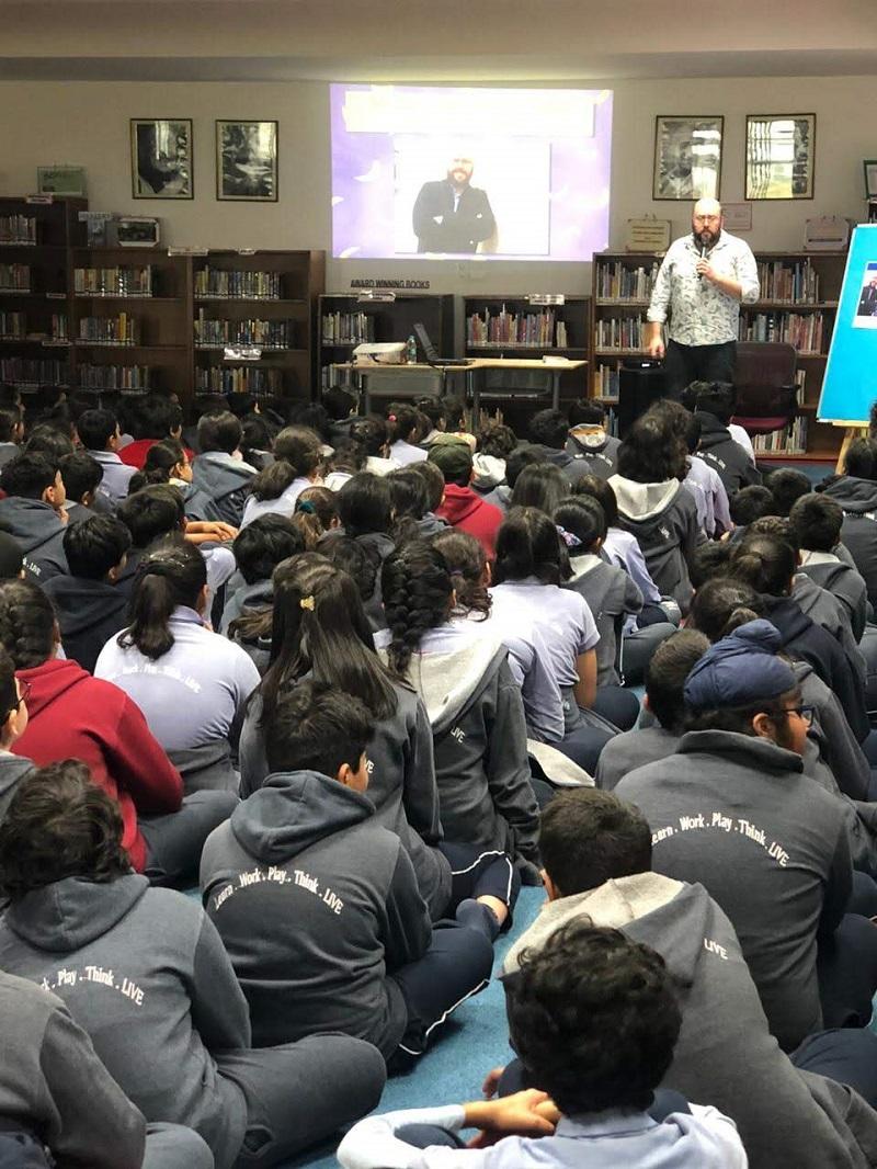 P.G. Bell talks to pupils at the Pathways international school