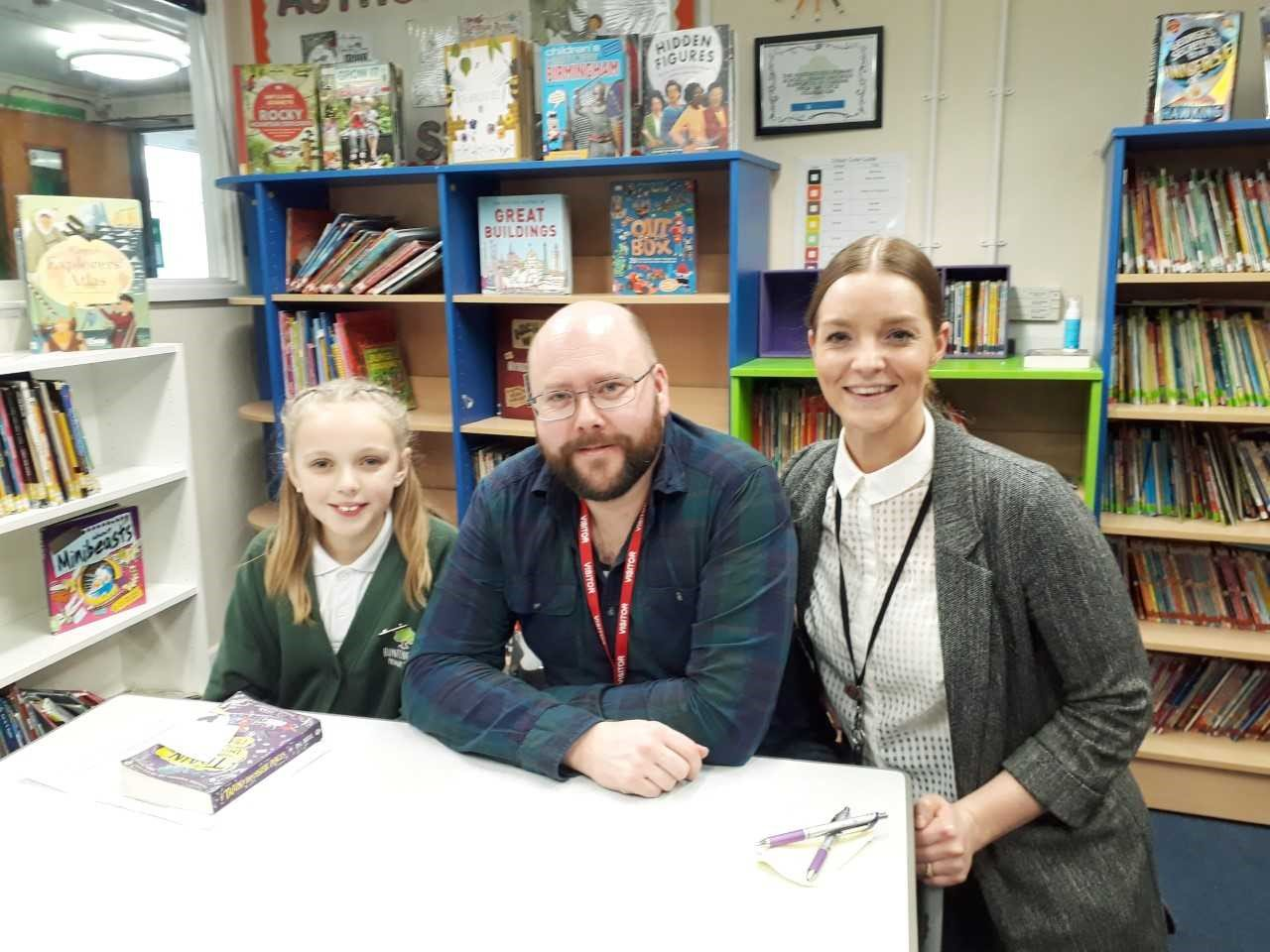 P.G. Bell with Alicia and Miss Samantha Jones of Huntingtree Primary