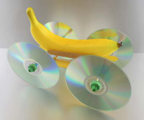 A banana car, made from a banana and four CDs as the wheels